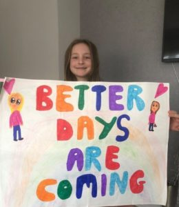 Art Gallery entry - young girl holding a sheet that says 'Better days are coming'