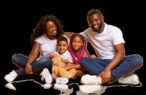 Mum, dad, boy, and girl pose with teddy bear