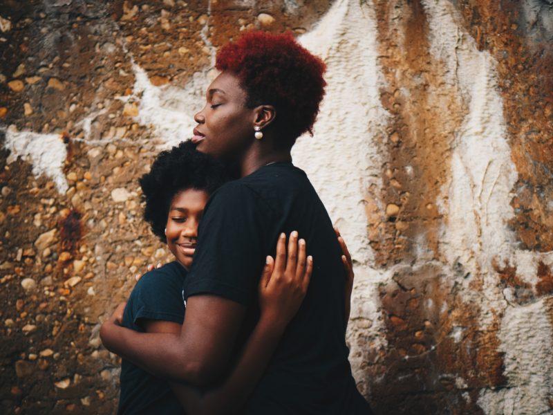 Two people hugging