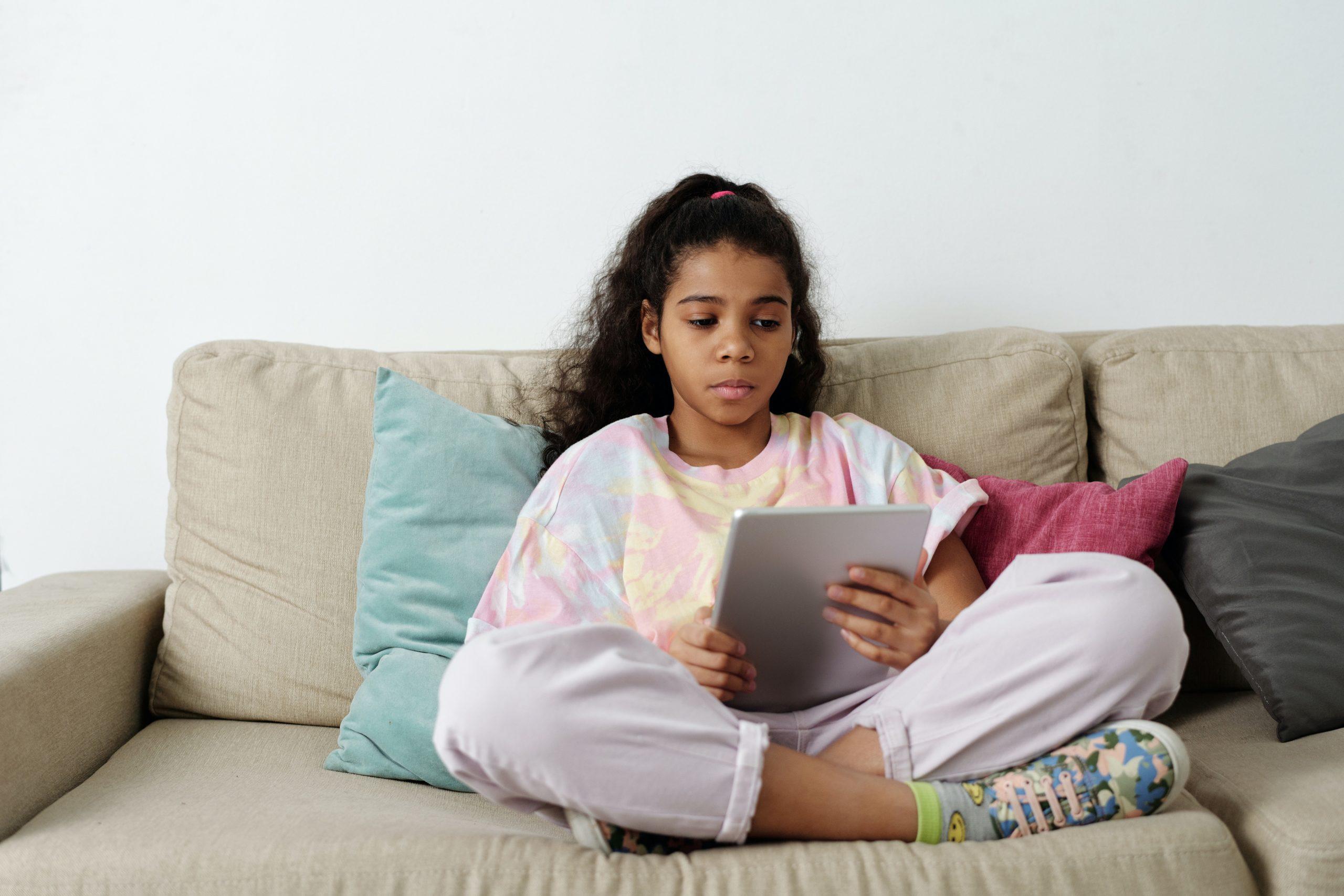 An anxious girl reading something on an iPad
