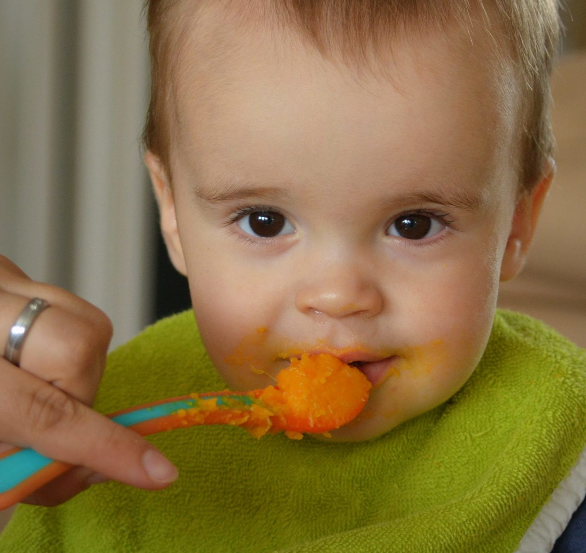 A baby being fed with a spoon