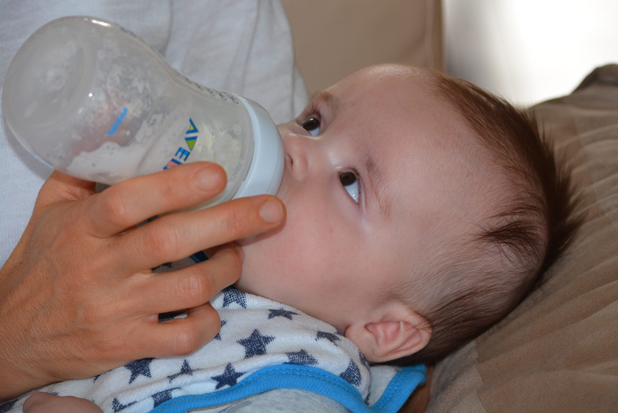 A baby being fed with a bottle