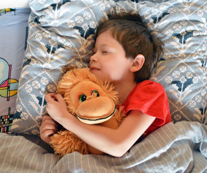Boy hugging stuffed toy
