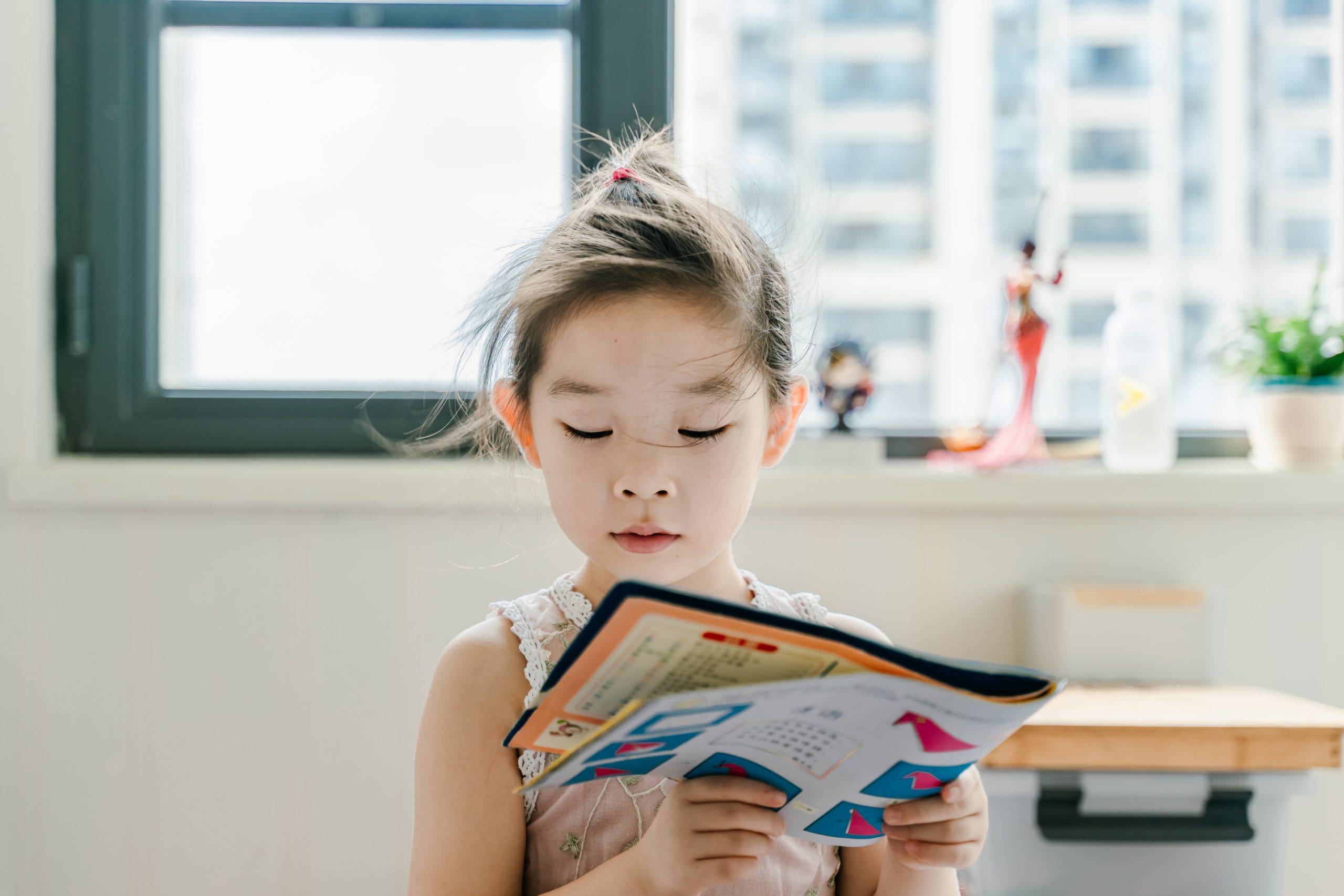 Young girl reading something