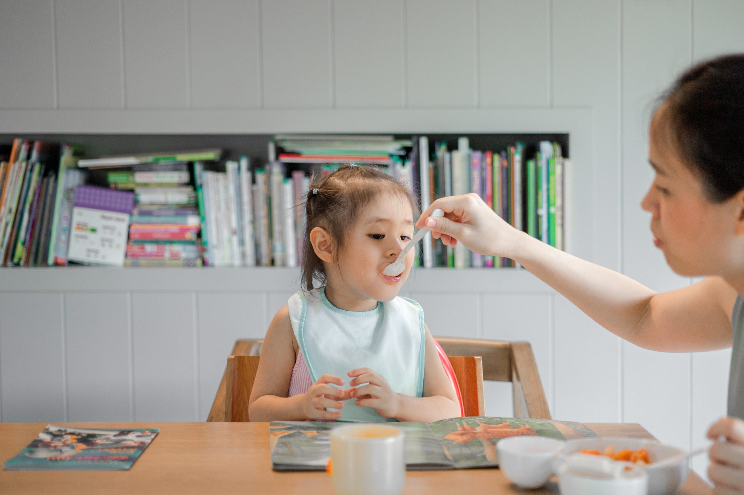 A toddler being fed