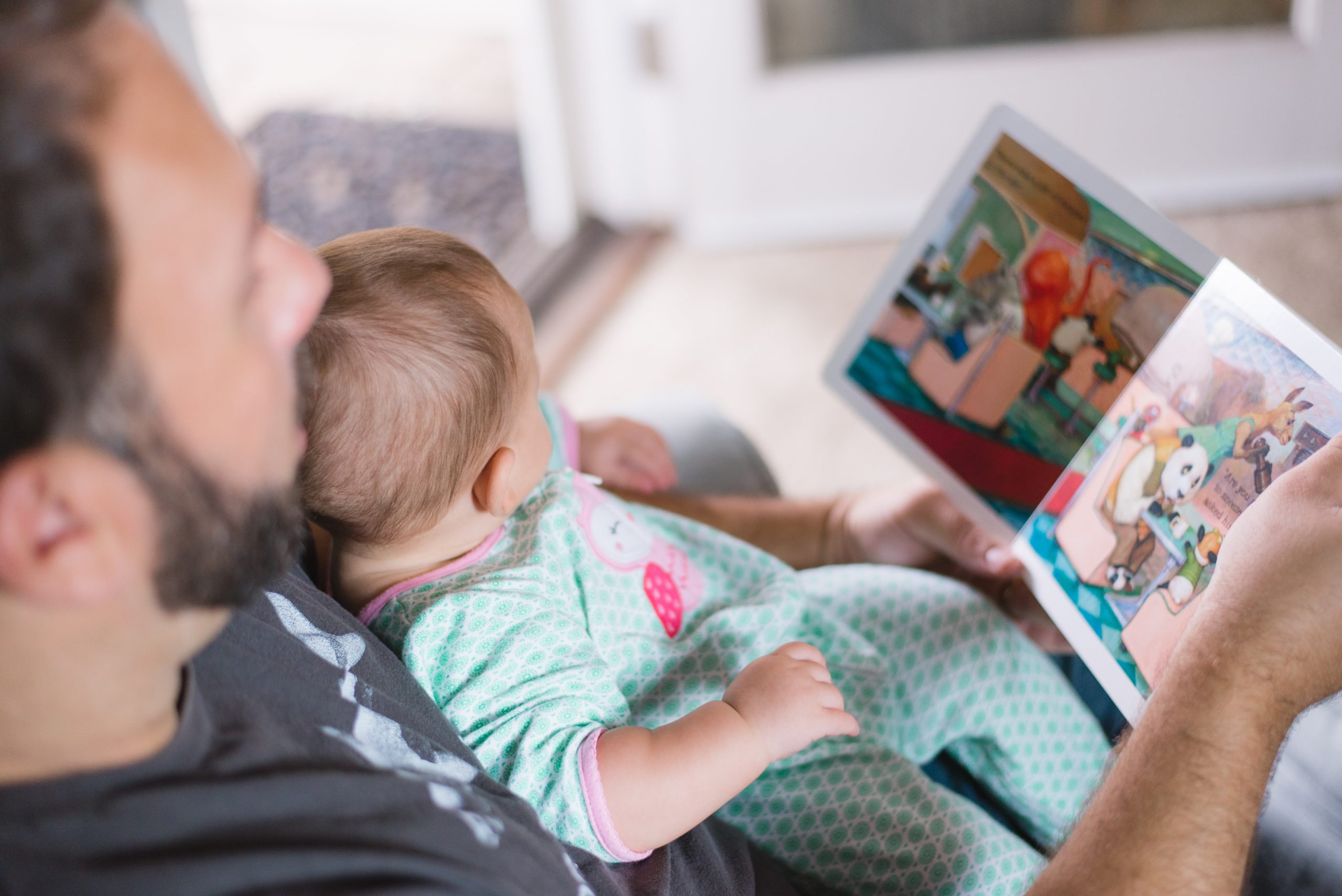 Dad reading to baby