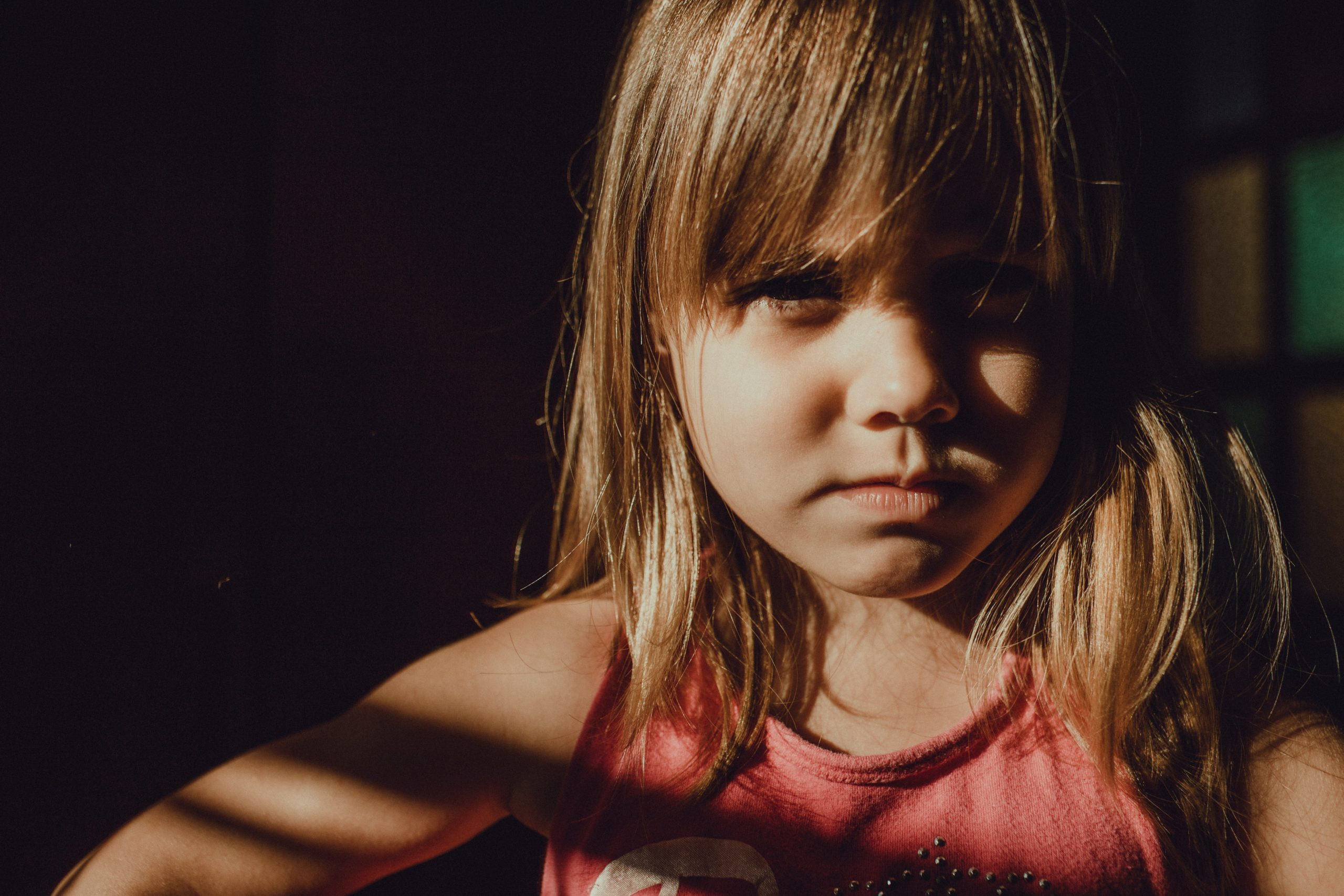 Pensive child looking into camera
