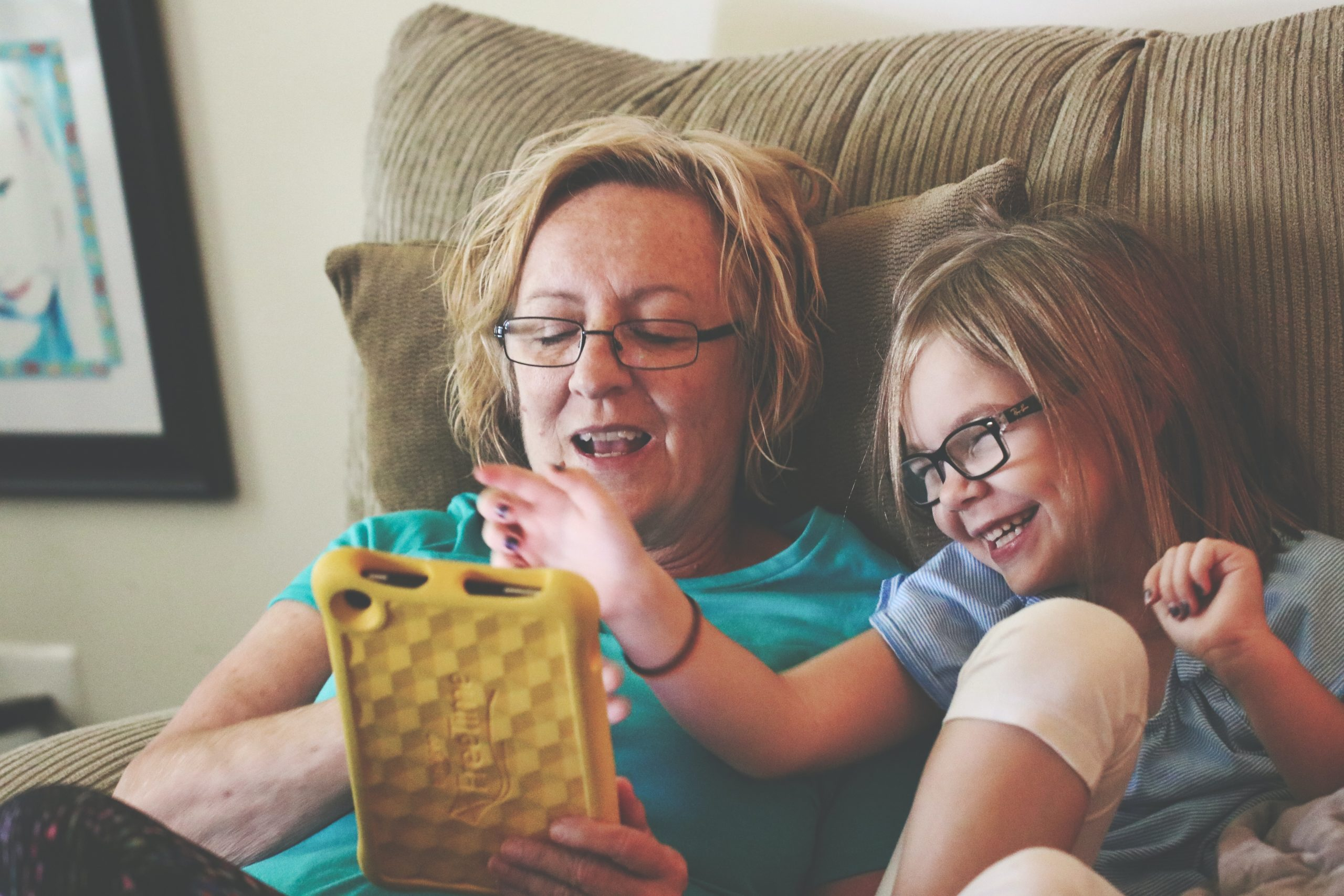 Mother and daughter playing a game on a phone