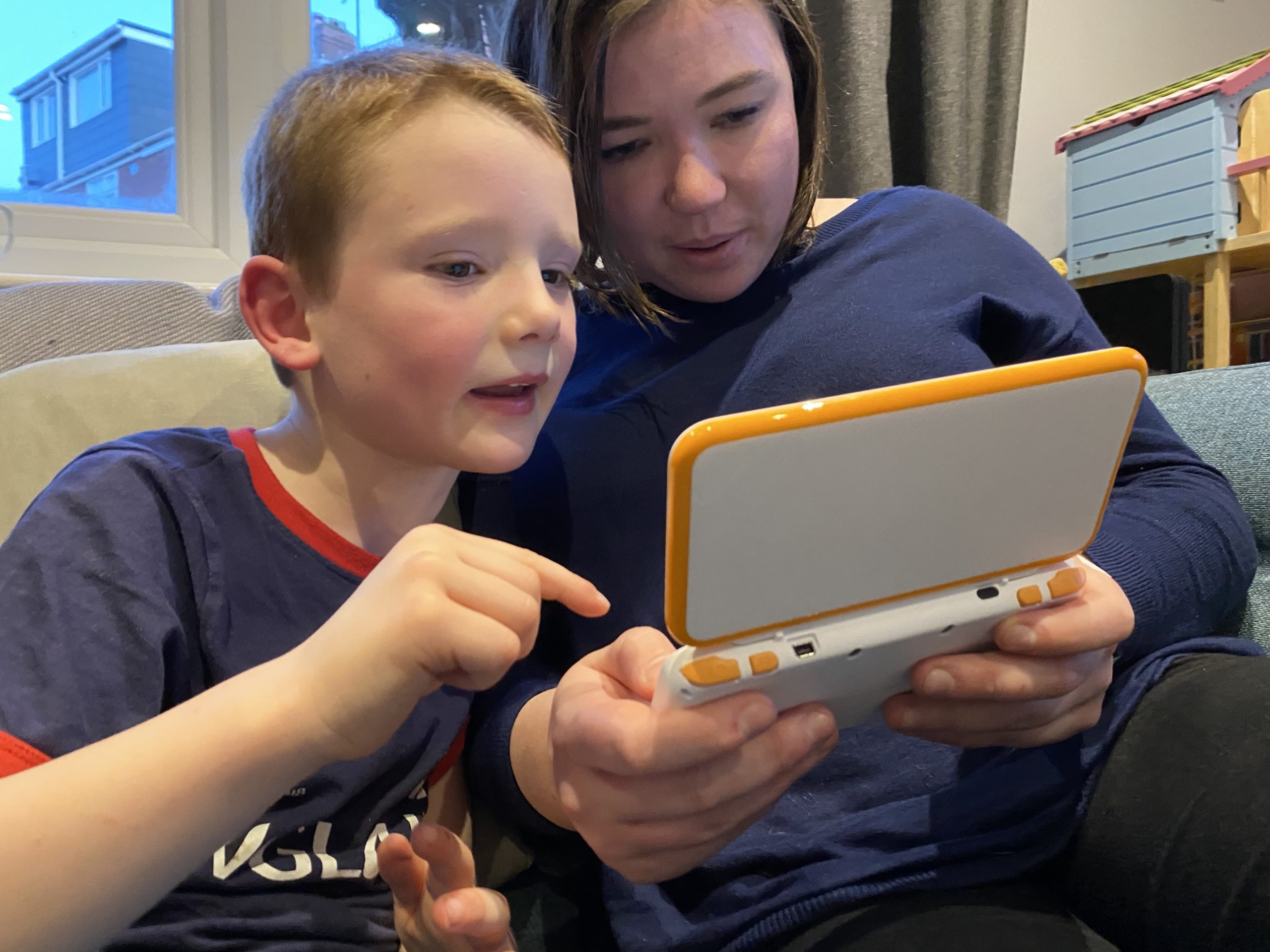 mum and child playing video games