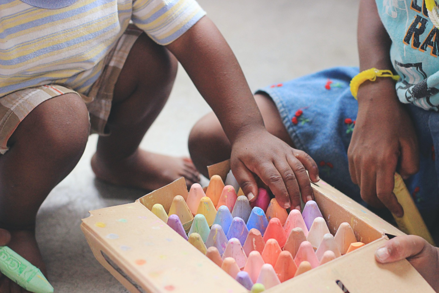 Toddlers with crayons