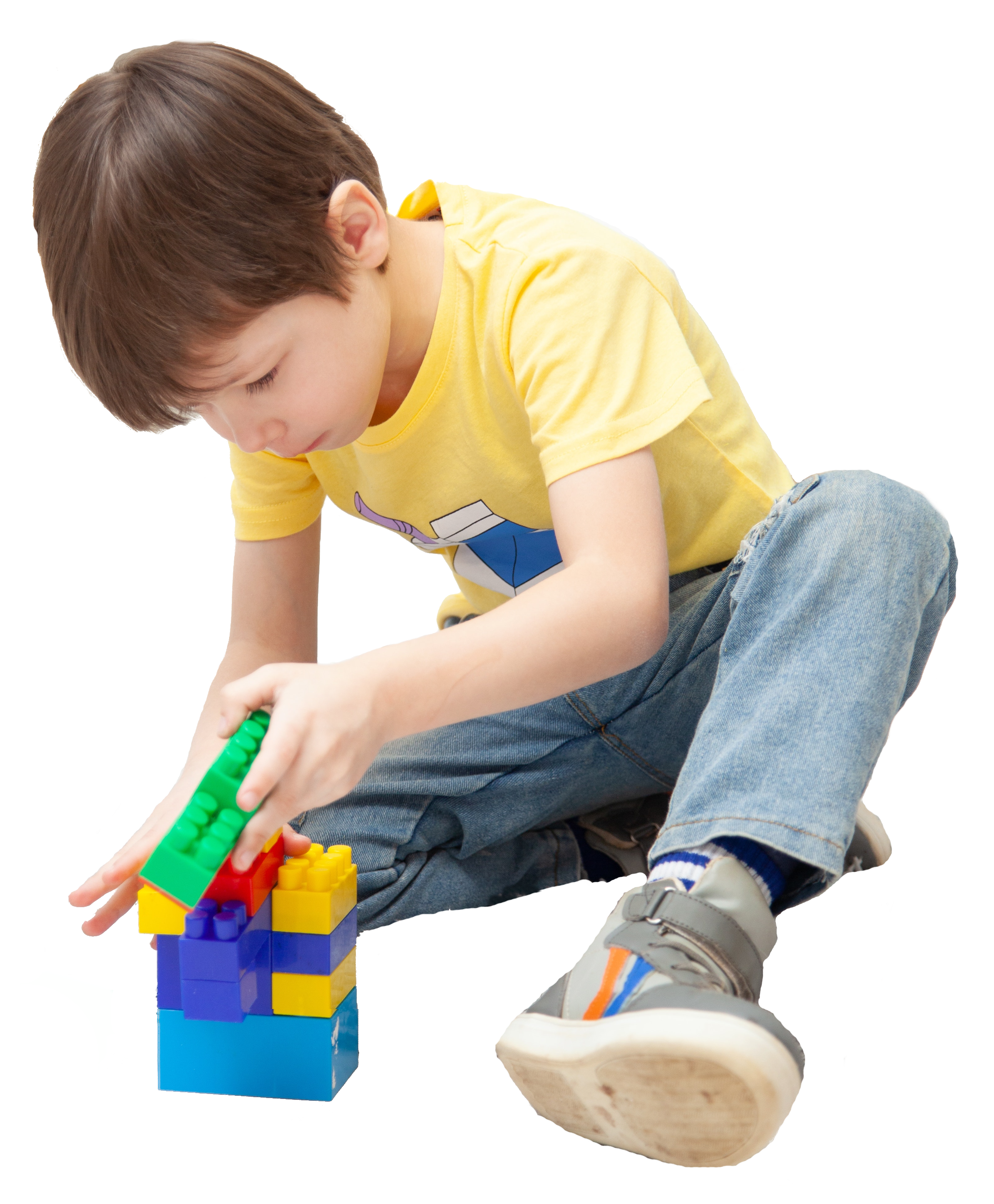 Child in yellow tshirt playing with blocks