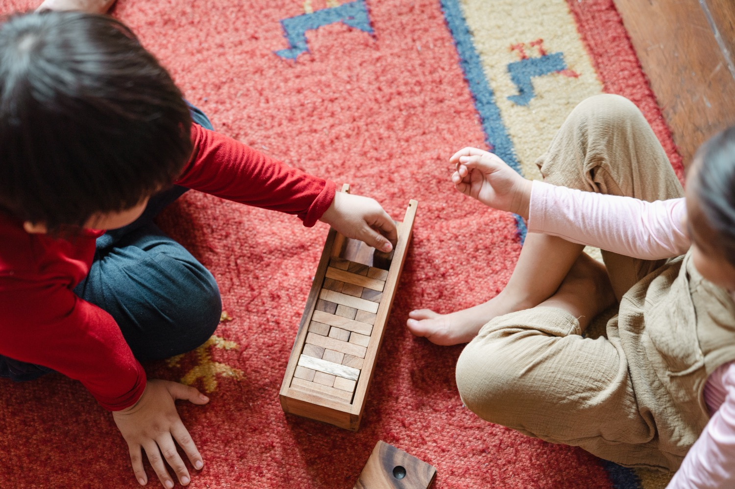 Children playing with blocks on carpet
