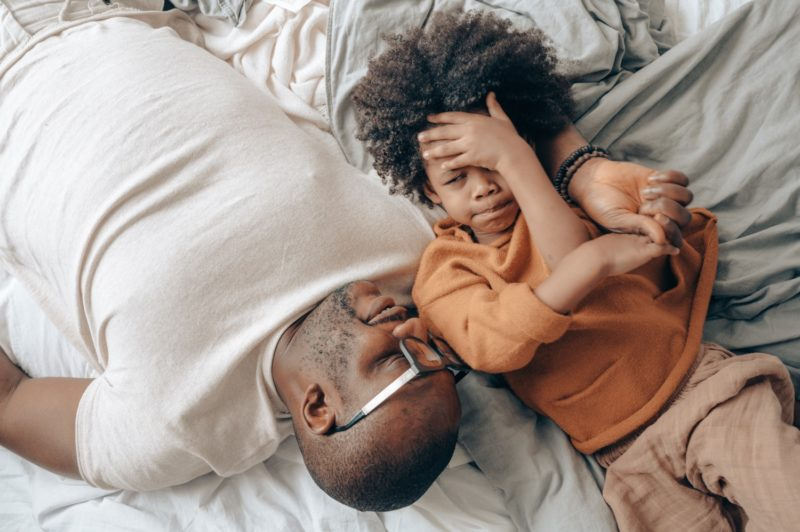 Emotional literacy - father and son talking on bed