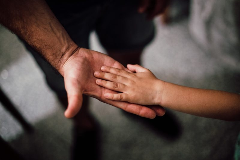 Sensory sensitivity - dad touching hands with child