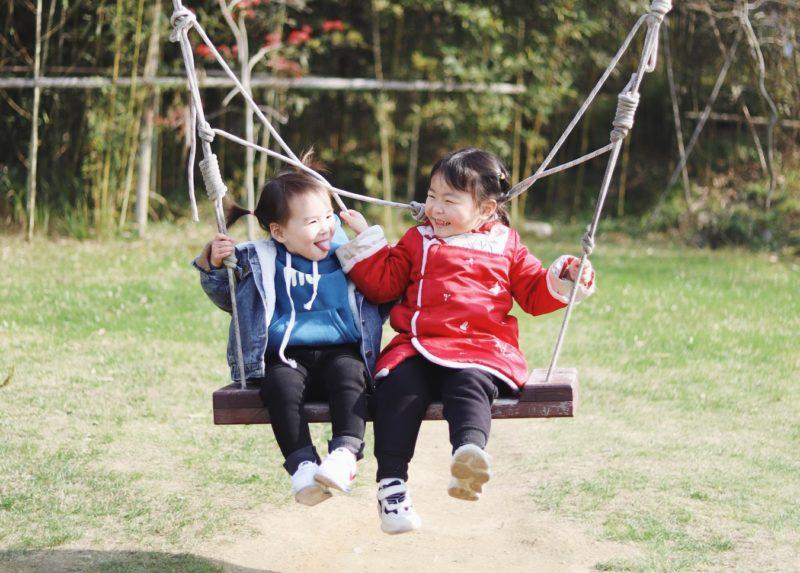 Child social skills - children on swing